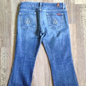 "7 For All Mankind ""A"" Medium Wash Flare Jeans"